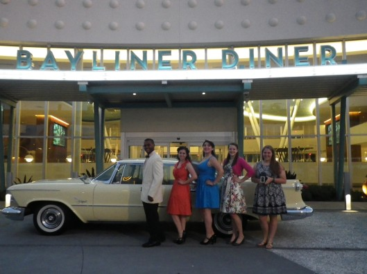 The group (minus Mickey) in front of the diner